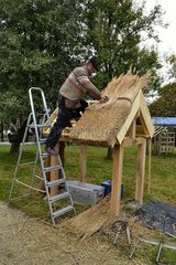 Demonstration of thatch roof creation in Normandy France