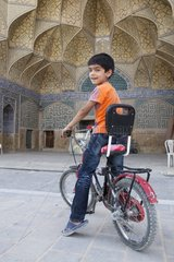 Boy in the courtyard of the Jameh mosque of Isfahan Iran
