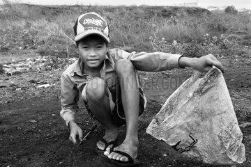 Boy on discharge Phnom Penh Cambodia