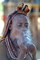 Himba woman having a cigarette Namibia