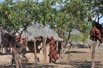 Himba village of mud huts and clay in Namibia