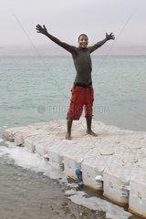 Jordan taking a mud bath in the Dead Sea Jordan