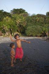 Children playing on a sandy beach - Tanna Island Vanuatu