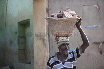 Mason removing rubble District Tamil Puducherry India