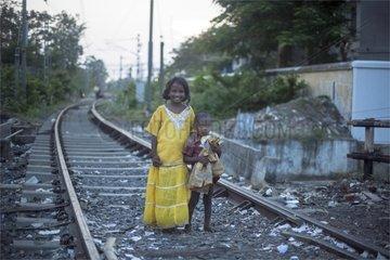 Girl and boy on track Tamil Nadu India