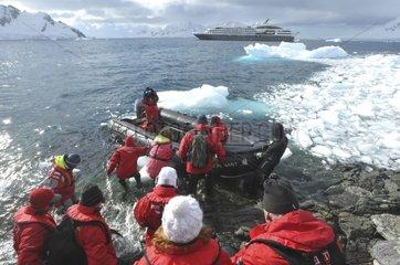 Tourists dinghy on the Antarctic coast