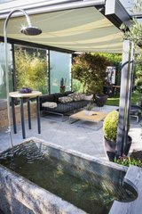Granite bathtub on a garden terrace