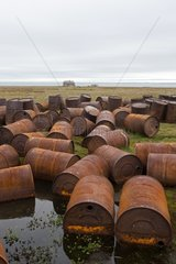 Gas cans rusted in a river - Chukotka Russia