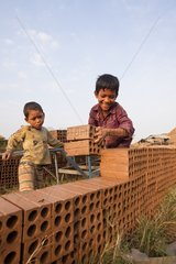 Manufactures clay bricks north of Phnom Penh Cambodia