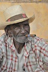 Portraits of Cuban man smoking a cigar in Trinidad Cuba