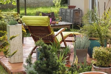 Teak deck chair on a garden terrace