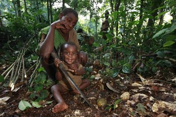 Pygmy Baaka child playing with a machete Cameroon