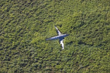 Aerial view of crashed plane in savannah Bolivia