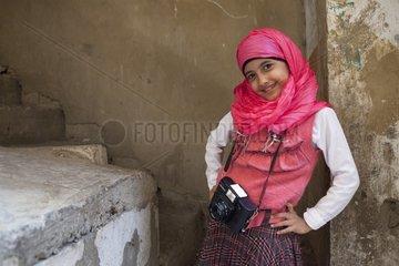 Girl in a class of Shatila with a camera - Lebanon