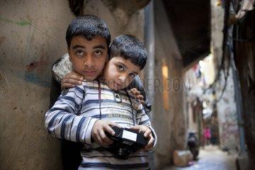 Boys in a class of Shatila with a camera - Lebanon