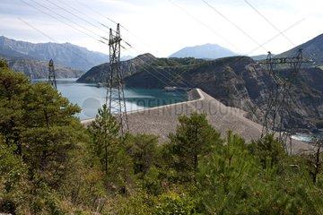 Dam of Serre-Ponçon and high-voltage line Alps France