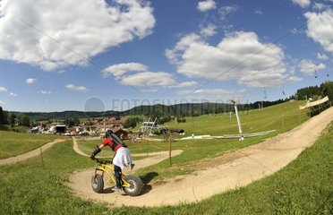 Downhill scootering on the ski slopes in summer Jura