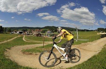 Downhill mountain biking on the ski slopes in summer Jura