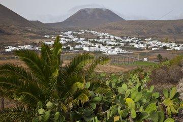 Landscape of a village and the volcano of La Corona in Lanzarote