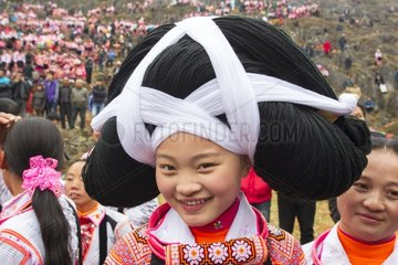 Long Horn Miao woman in traditional clothes - Guizhou China
