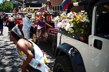 Arrival of the Queens Hispanic Parade at the celebration of the Flower Festival in New York  along 37th Avenue  from 69th to 82nd streets.