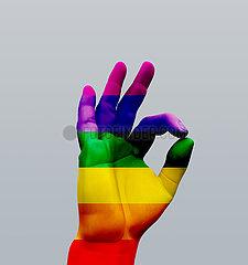 Human hand OK sign  rainbow