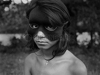 Maedchen mit Maske