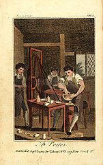 Potter making a clay vessel on a wheel driven by a labourer turning a crank.