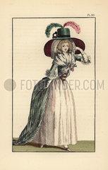 Woman in redingote  skirt and chapeau-feutre.