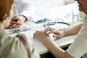 Mother and daughter talking with doctor