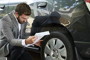 Man examining car