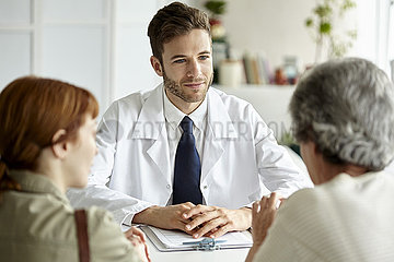 Senior patient talking with doctor