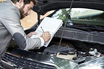 Man writing on documents