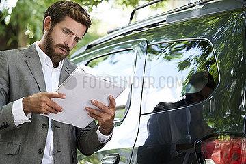 Salesman reading documents