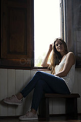 Smiling woman sitting near window