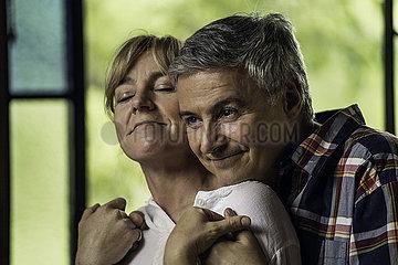 Couple embracing indoors