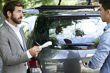 Salesman talking with client