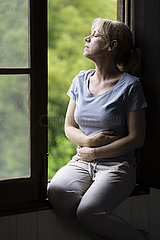 Woman sitting on window