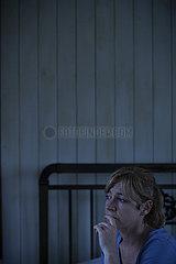 Worried woman sitting indoors