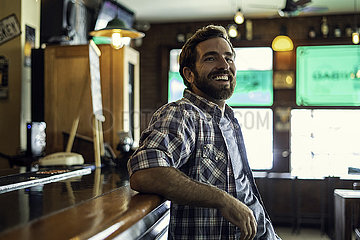 Man leaning against bar counter