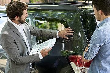 Salesman assisting customer