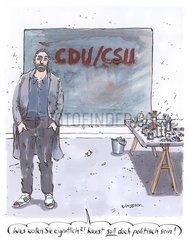 Kuenstler steht vor seinem Kunstwerk Kuenstler steht vor seinem Kunstwerk