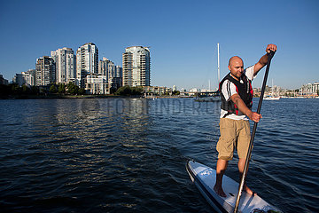 surf paddling in Vancouver bay