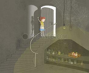 Kind drückt Lichtschalter im Keller