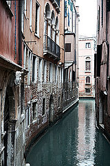 Canal and houses in the rain in Venice