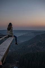 Woman enjoys a peaceful and calm sunrise