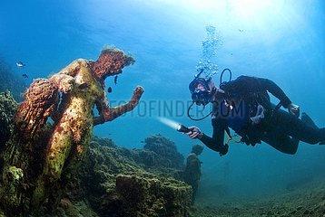 Diver with statue of greek God Dionysus. Baia (Baiae)  Campi Flegrei (Phlegraean Fields)  Naples  Campania  Italy