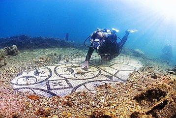 Diver swimming over a submerged ancient Roman mosaic. Baia (Baiae)  Campi Flegrei (Phlegraean Fields)  Naples  Campania  Italy