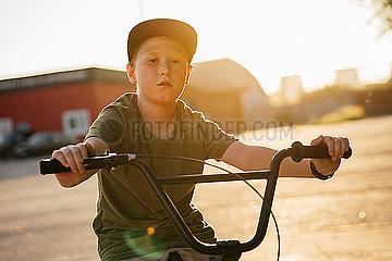 Portrait of serious boy with bmx bike
