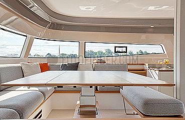 Main saloon inside a luxurious catamaran cruising on the Garonne river